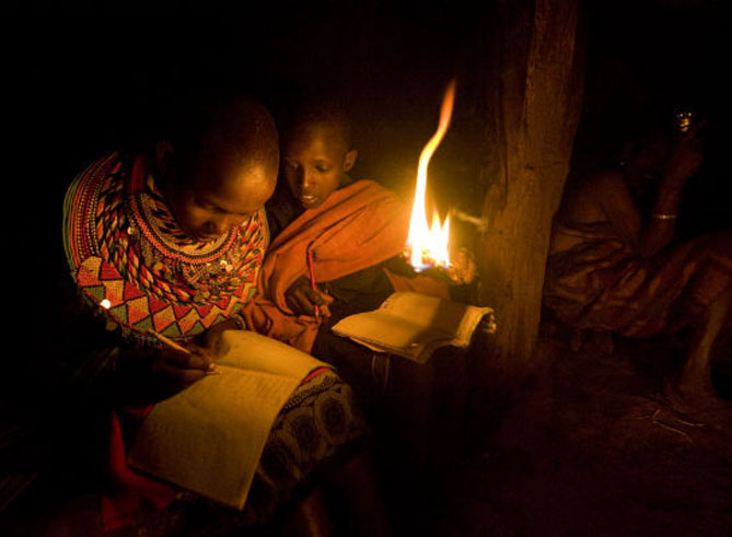 Lack of electricity can mean resorting to unsafe lighting/heating methods. Credit: Power Africa / Sirleaf.
